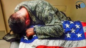 Touching Moment Of A Soldier Hugging His Dead K-9 Partner
