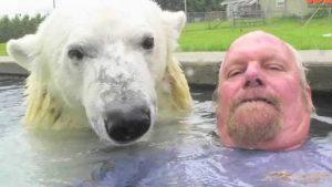 Polar Bear And Man Have Incredible Bond