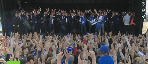 20,000 Icelandic fans do the viking clap with their soccer team to show support